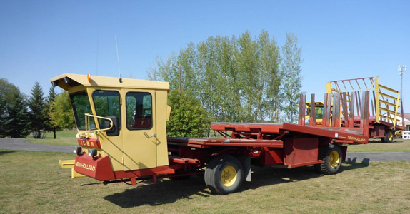 New Holland 1069 Stack Cruis bale wagon selling at Ritchie Bros. auctions