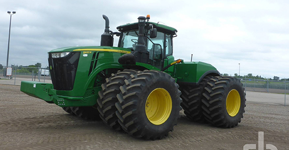 2016 John Deere 9620R 4WD tractor sold by Ritchie Bros.